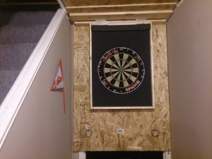 the completed dartboard cabinet -- dartboard with foam surround